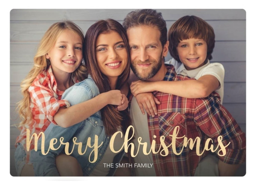 Holiday card with Merry Christmas message in gold script and portrait of mom, dad, daughter, and son