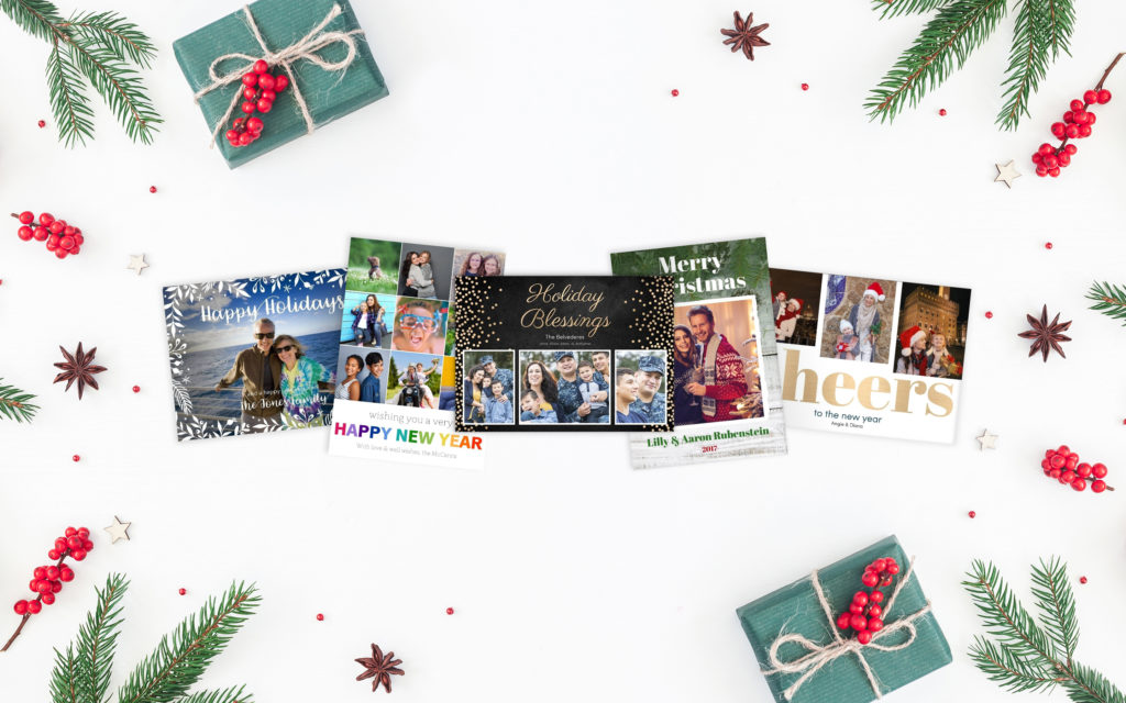 5 holiday cards on white background surrounded by small gifts