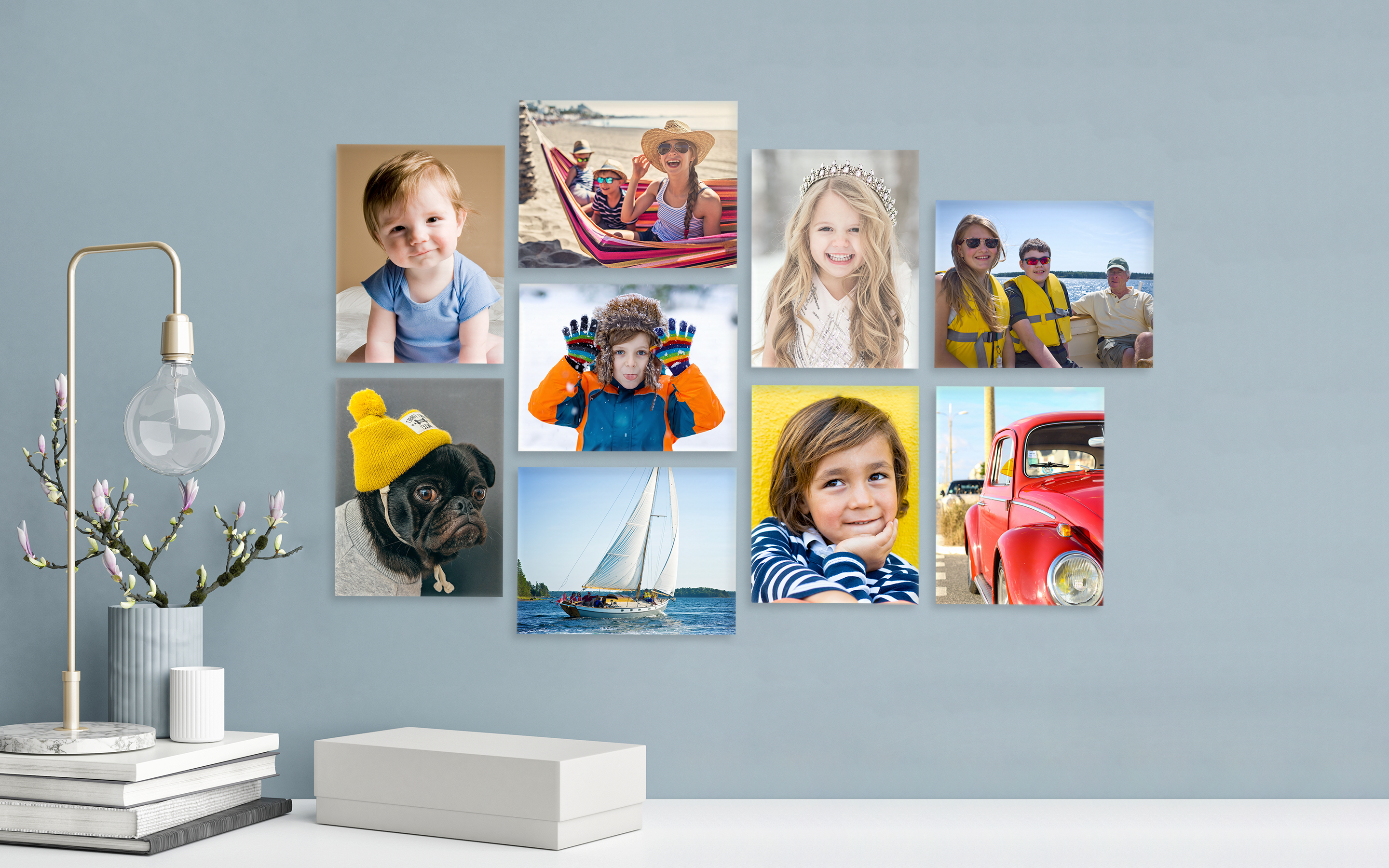 Light blue wall with various photo canvas prints