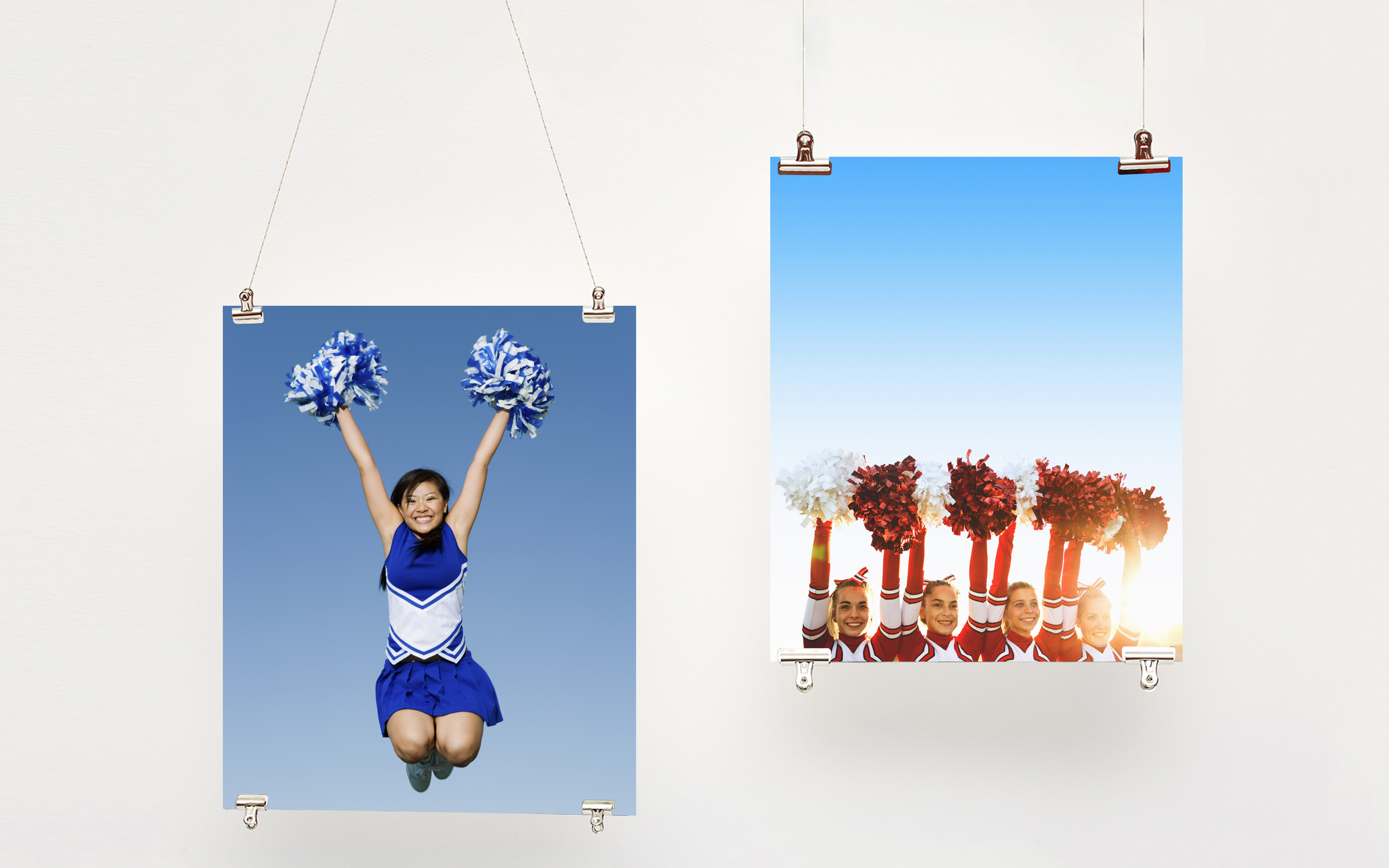 Two hanging posters with photos of cheerleaders