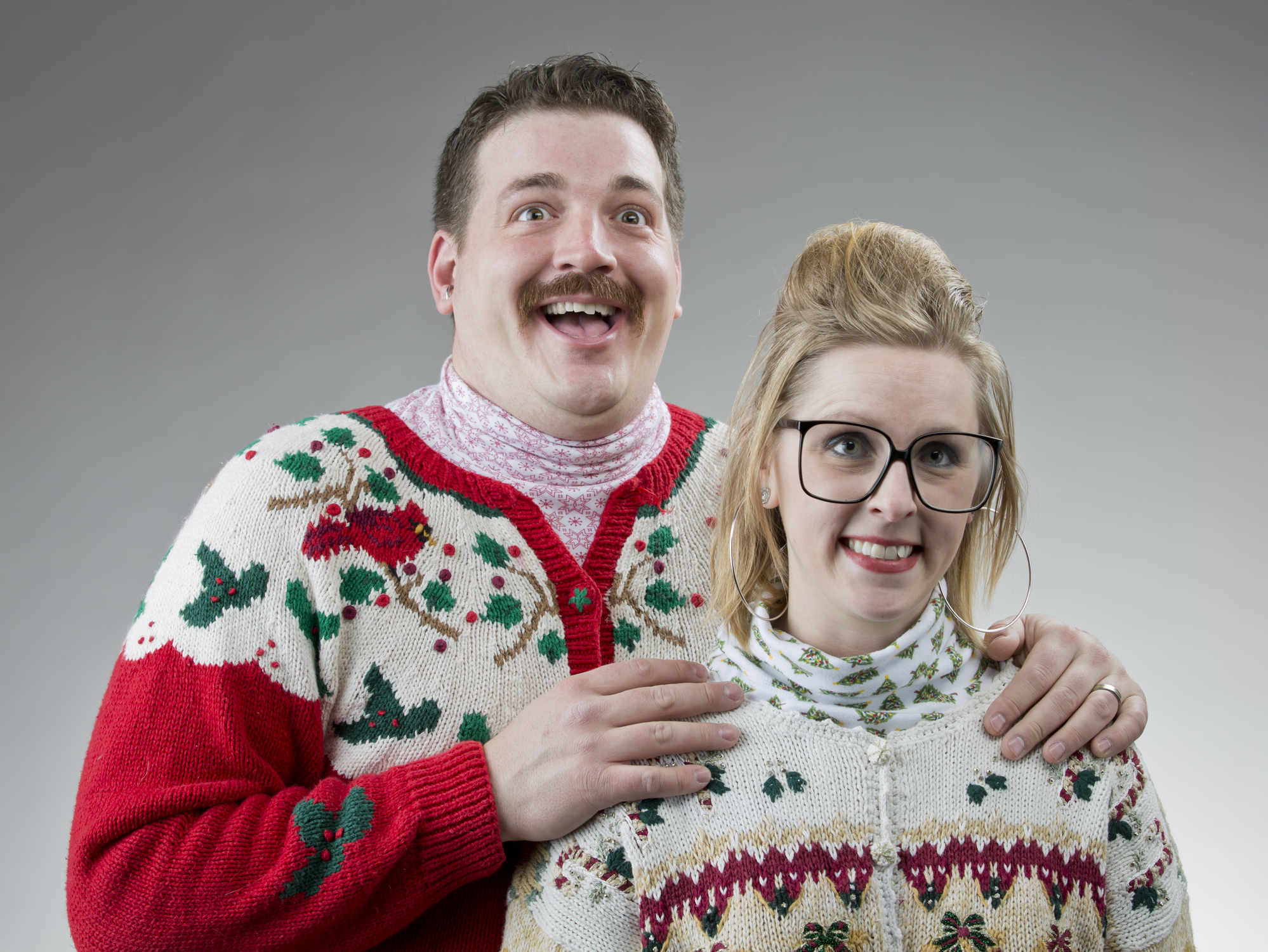 Awkward photo of couple in Christmas sweaters
